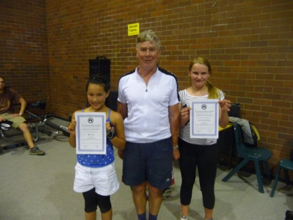 Photograph shows Mai and Lauren with their certificates from Rod